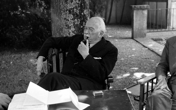 Carl Jung in his house's garden sitting and smoking pipe in Knusnacht, Switzerland, 1949 (1)